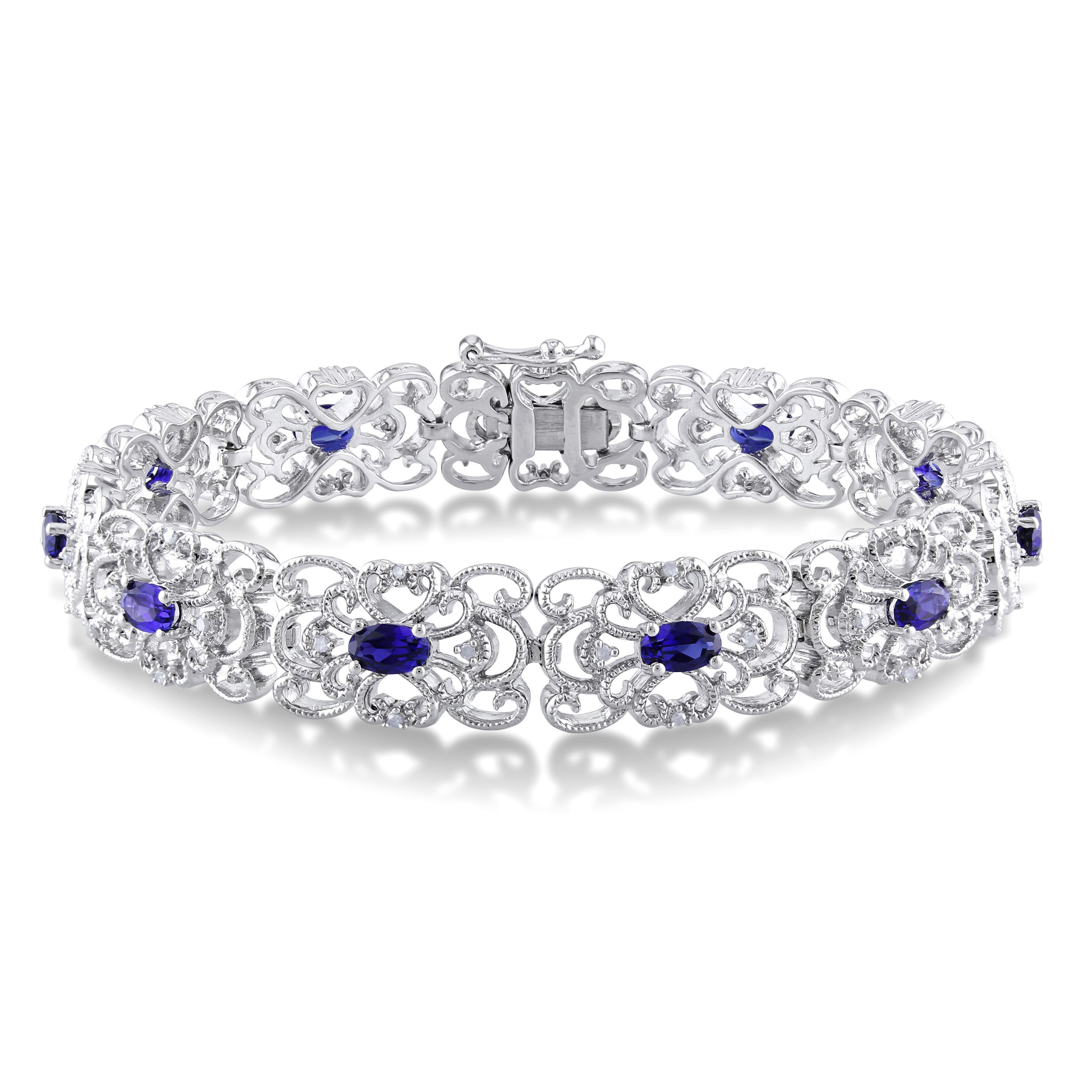 This shimmering bracelet from the Miadora Collection features 11 oval-cut created blue sapphires and 43 round white diamonds set in sterling silver. This lovely piece is secured with a box-with-tongue clasp.