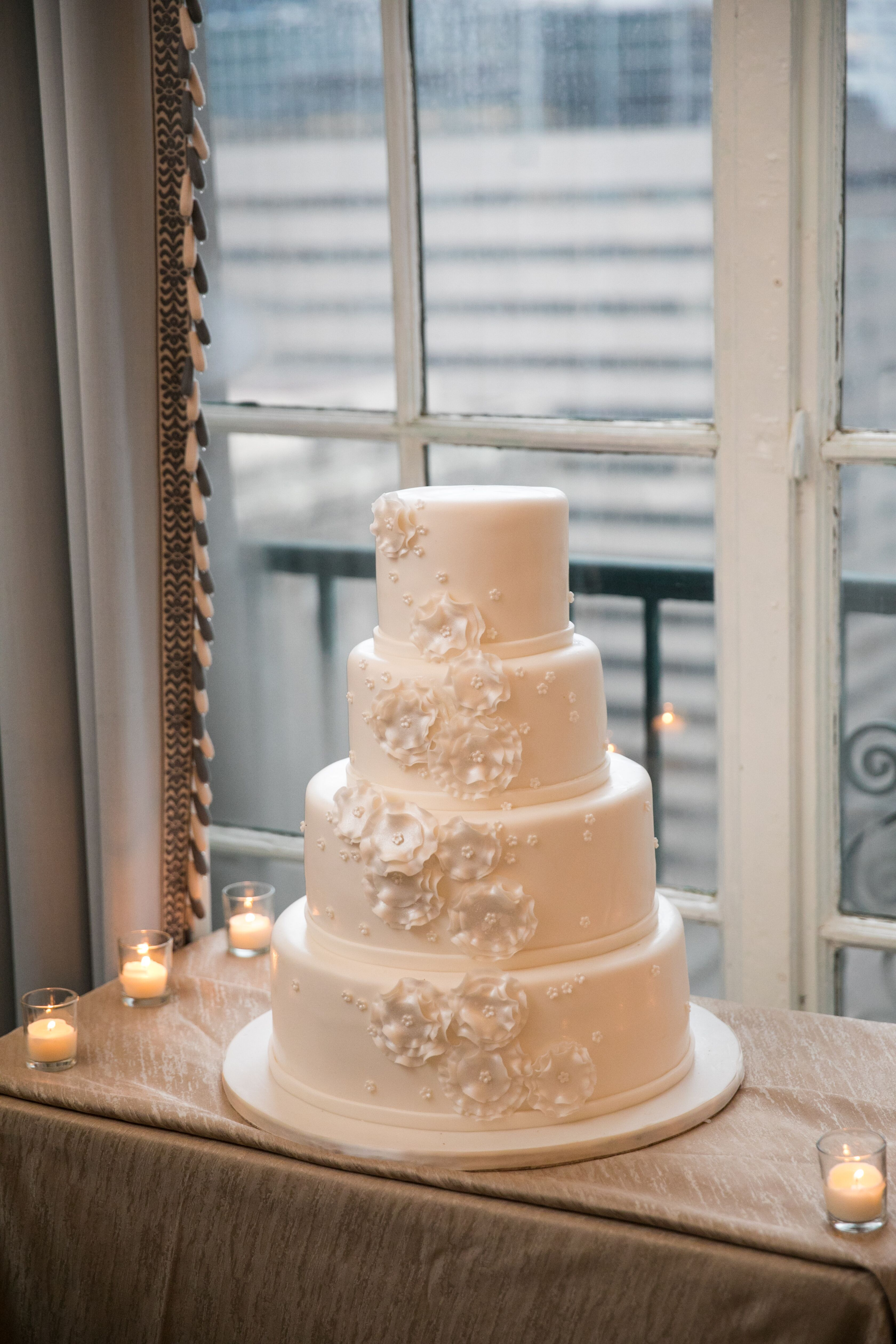 All white cascading floral wedding cake at The Yale Club of New ...