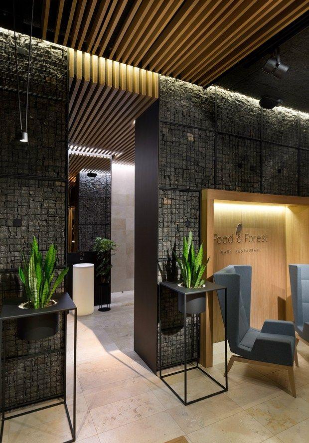 Pietra legno corten e cuoio in armonia con la natura for Appartamento design industriale