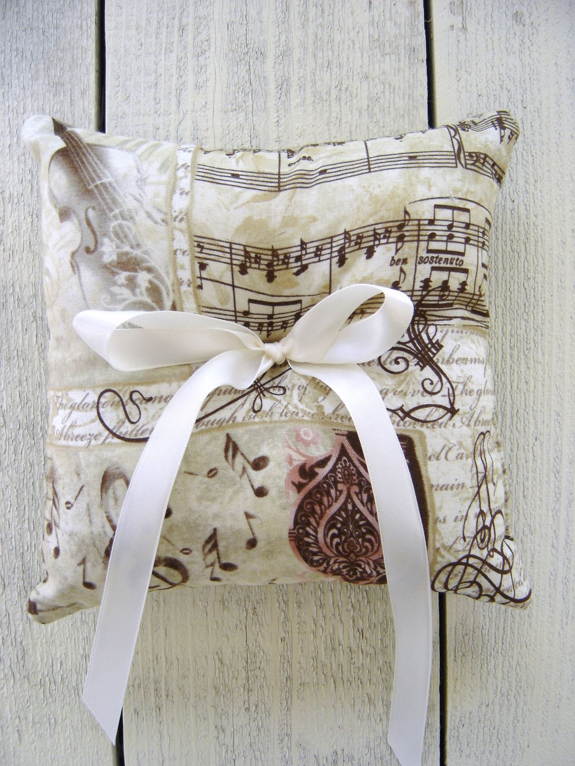 Ring Bearer Pillow - Music Notes / Script / Vintage / Violin. $15.00, via Etsy.    Oh How I would have liked to have this at our wedding <3