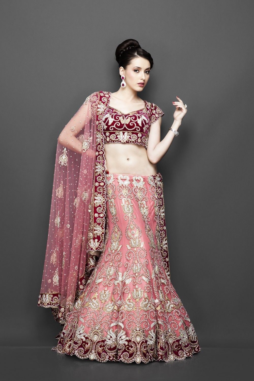 South asian wedding dresses  Peachpink lehenga with velvet blouse  South Asian Glamour