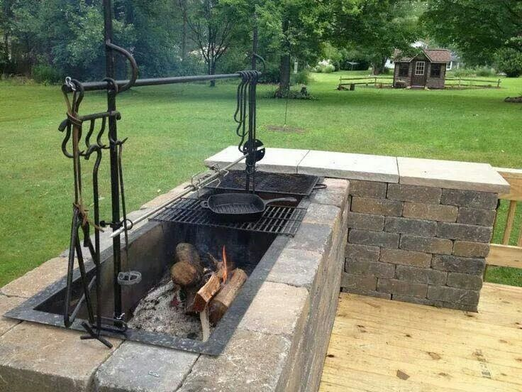 Built in fire pit hard wood charcoal etc cook on grill