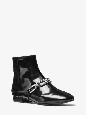 Expertly crafted in Italy from glossy Spazzolato leather, our Lennox ankle  boots are detailed with chain-link hardware. The versatile silhouette  showcases a ...
