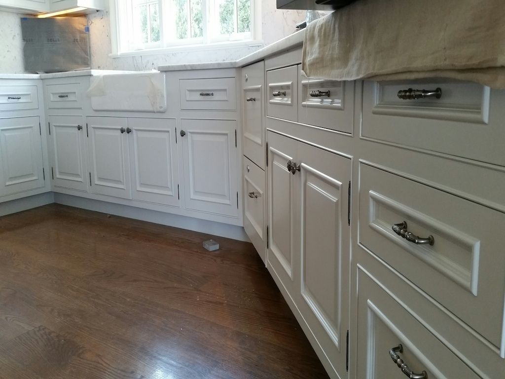 These Cabinets Look Beautiful The White Paint Looks Glossy And Classy And Goes Great With The Wood Flooring The Silver Han Home White Cabinets Exterior Paint