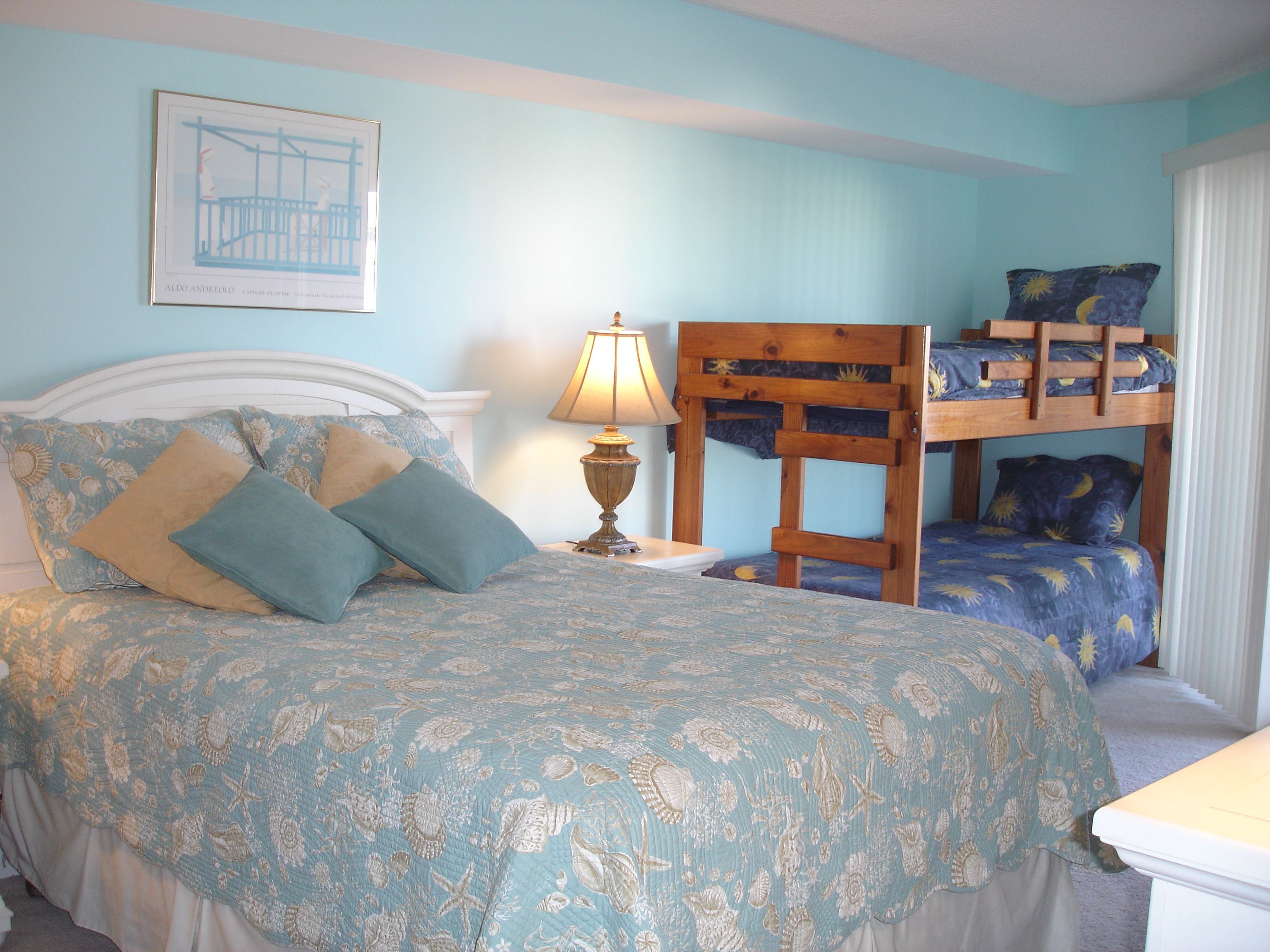 Large one Bedroom with a queen bed and a set of bunk beds