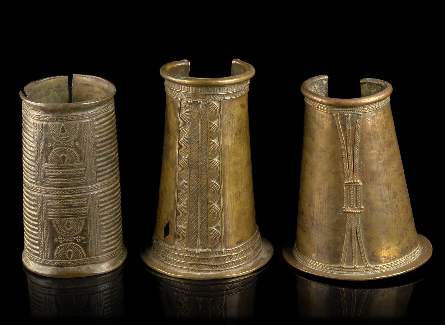 Africa | Three brass cuffs from West Africa | Left) From the Igbo people of Nigeria. Center and Right) From Burkina Faso | 450€ for the lot ~ sold