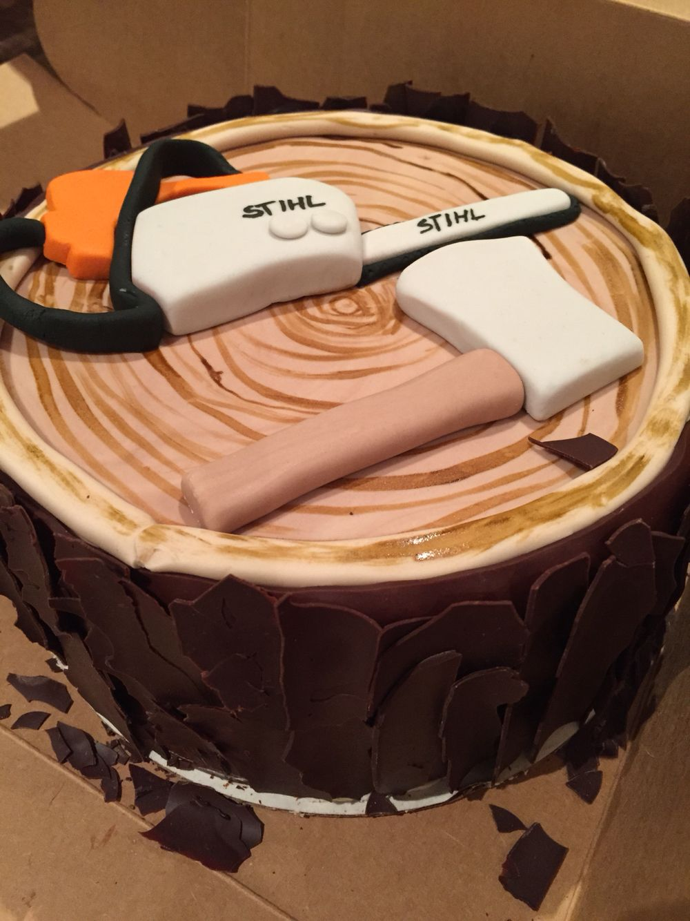 Woodsy cake with ax and chainsaw
