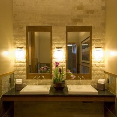 Contemporary tropical bathroom love the stone back wall for Tropical hotel decor