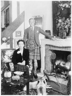 Duke and Duchess of W at fireplace