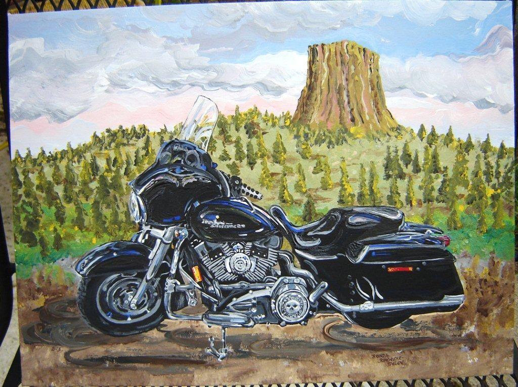 A Harley Davidson Motorcycle In Front Of Devils Tower Devils
