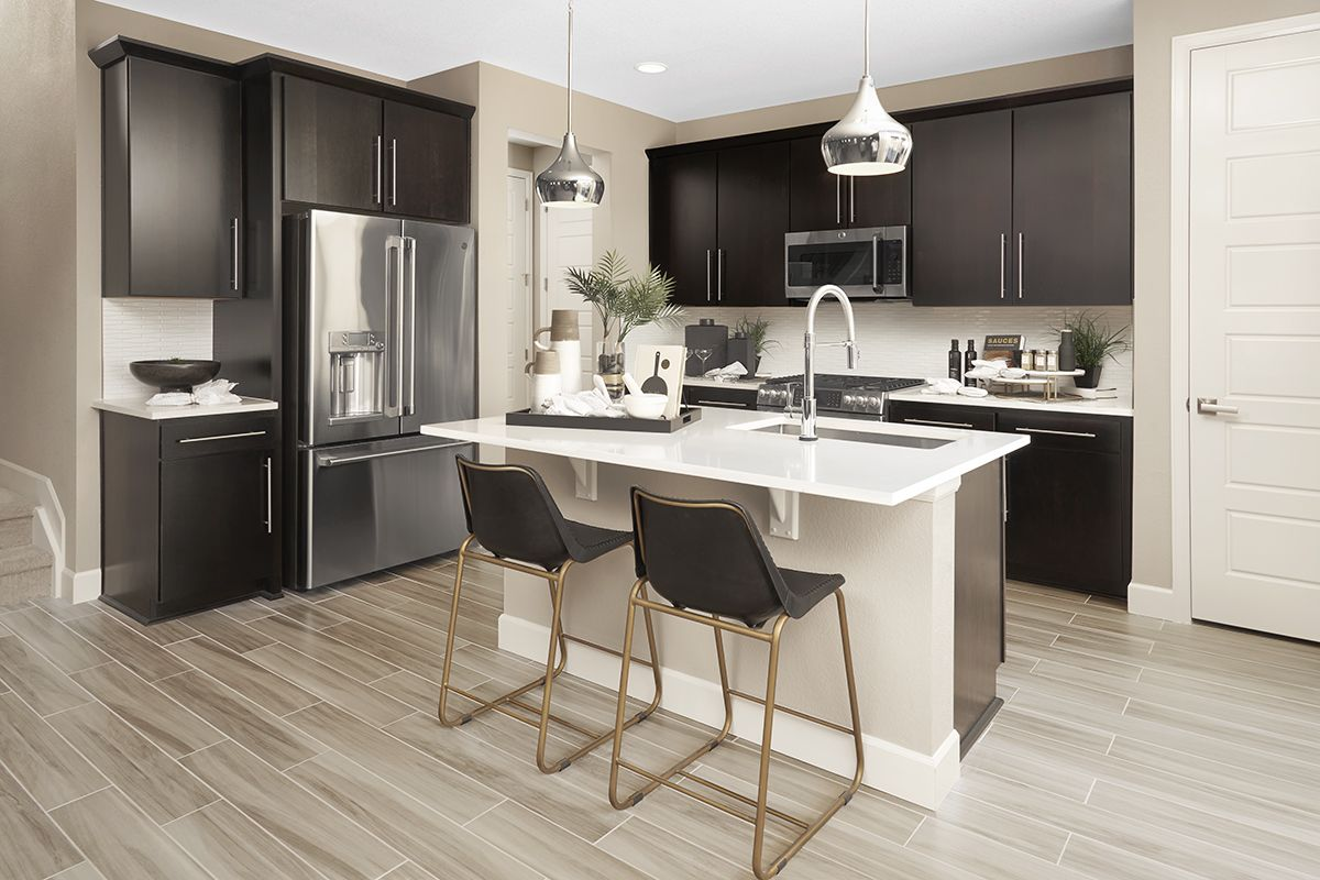 Light backsplash and countertops contrast with dark ... on Model Kitchen Ideas  id=77680