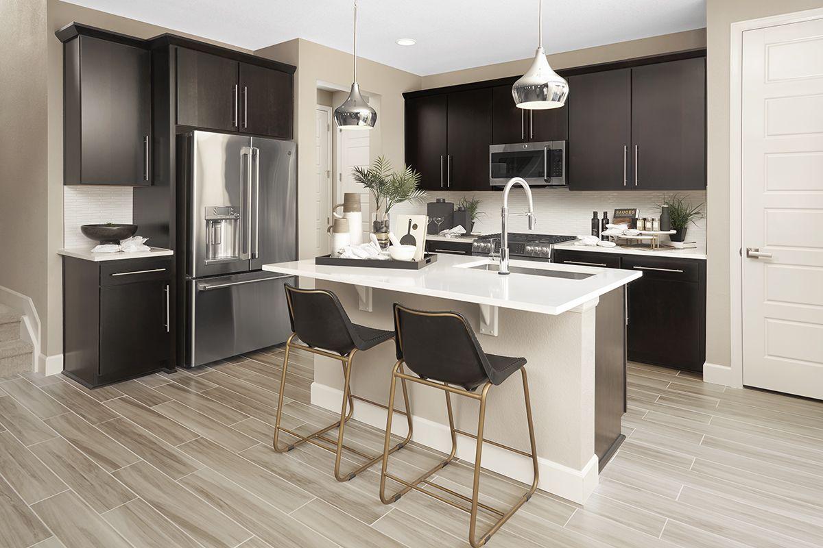 Light backsplash and countertops contrast with dark ... on Model Kitchen Ideas  id=77680