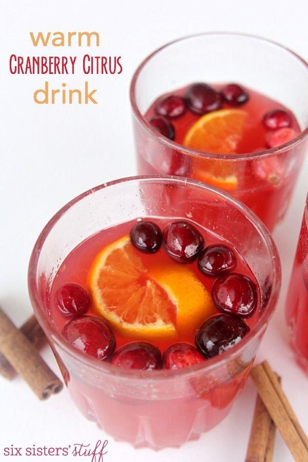 Warm Cranberry Citrus Drink on SixSistersStuff.com | My mother-in-law had this drink simmering the last time we were at her house and it was seriously the best thing for our sore throats! Keep the leftovers in the fridge and then heat up a cup when you need something to warm you up and soothe your throat.