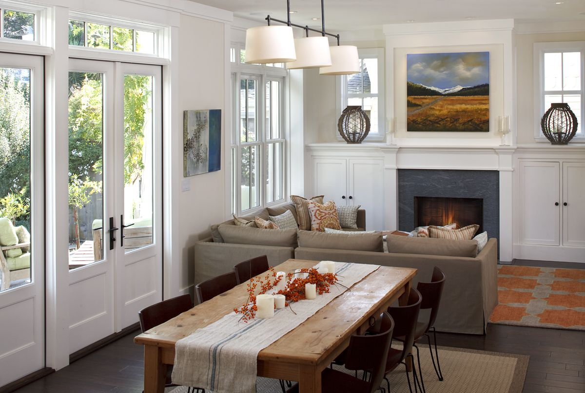 The French Doors And Table Itself All Bring This Space To Life Without Losing Fireplace Traditional Dining Room By Artistic Designs For Living