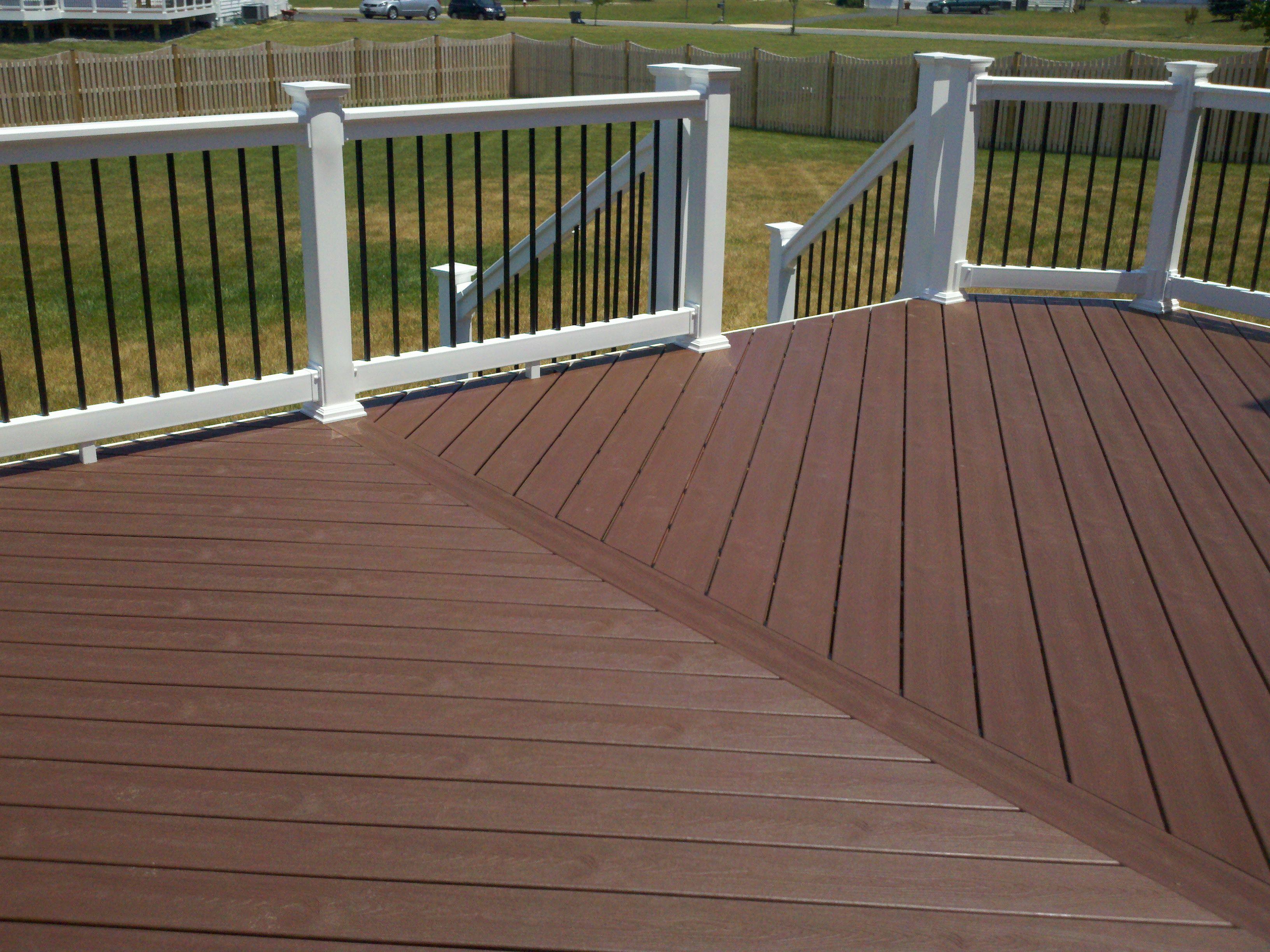 Composite Deck In Herringbone Pattern Dark Wood Decking Composite Decking Wood Deck Railing