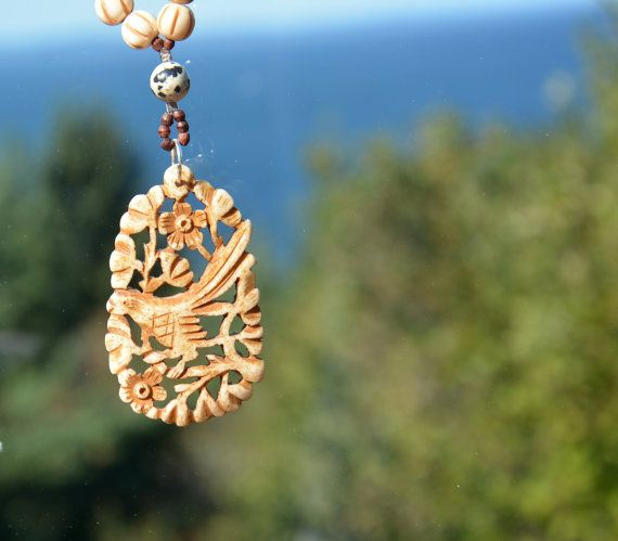 This listing is for a one of a kind Mala necklace created with 108 round bone beads and featuring a hand carved pendant sourced from India. The