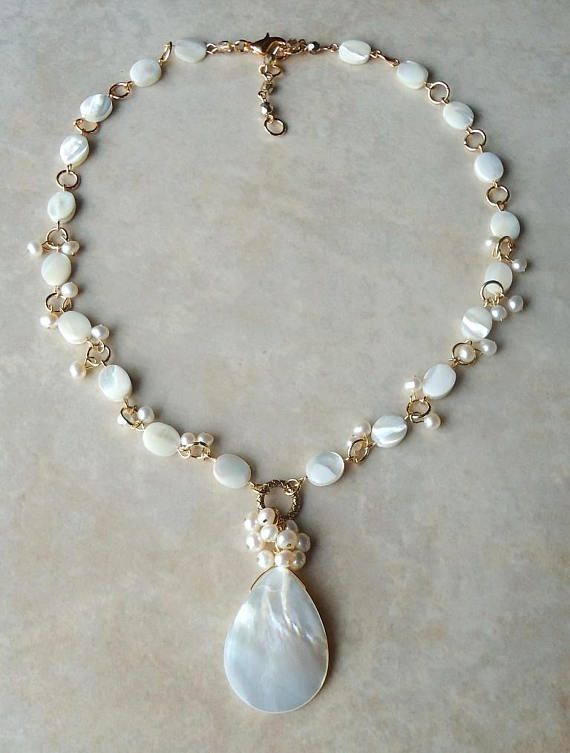 Mother of pearl pendant necklaceeshwater pearl clusterwhite mother of pearl pendant necklaceeshwater pearl aloadofball Choice Image