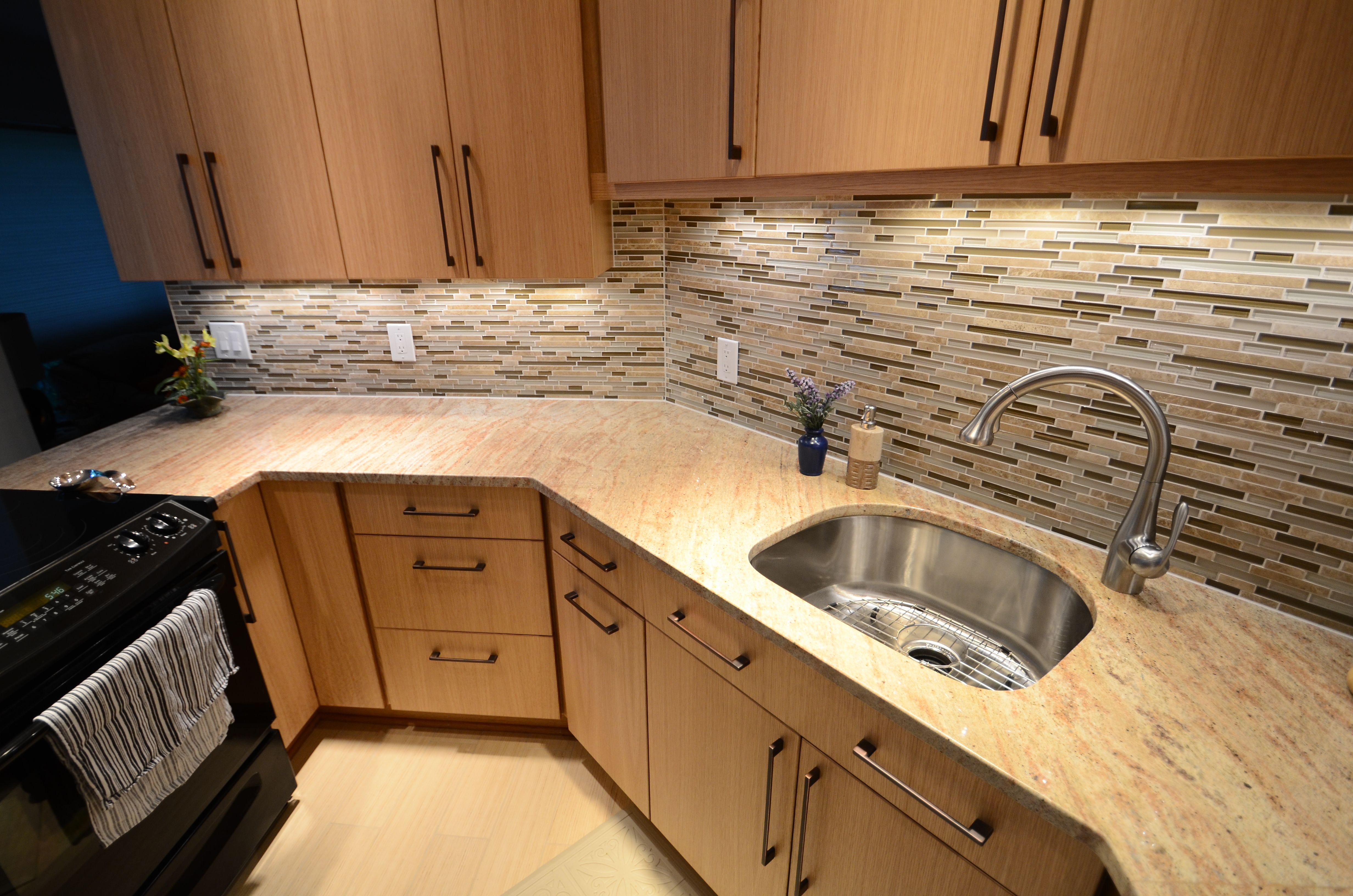 A softer look in this contemporary kitchen. White Oak veneered ...