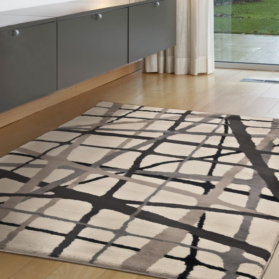 Layer An Abstract Area Rug In Your Room For A Contemporary Vibe The Neutral Colors Make Accessorizing A Cinch Living Room Area Rugs Area Rugs Indoor Area Rugs