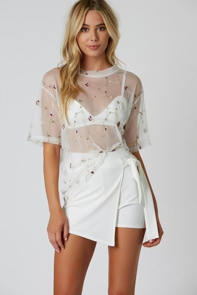5dd9714f802d6 Lightweight short sleeve mesh top with floral embroidery throughout.  Bralette lining underneath with oversized fit and straight hem finish.