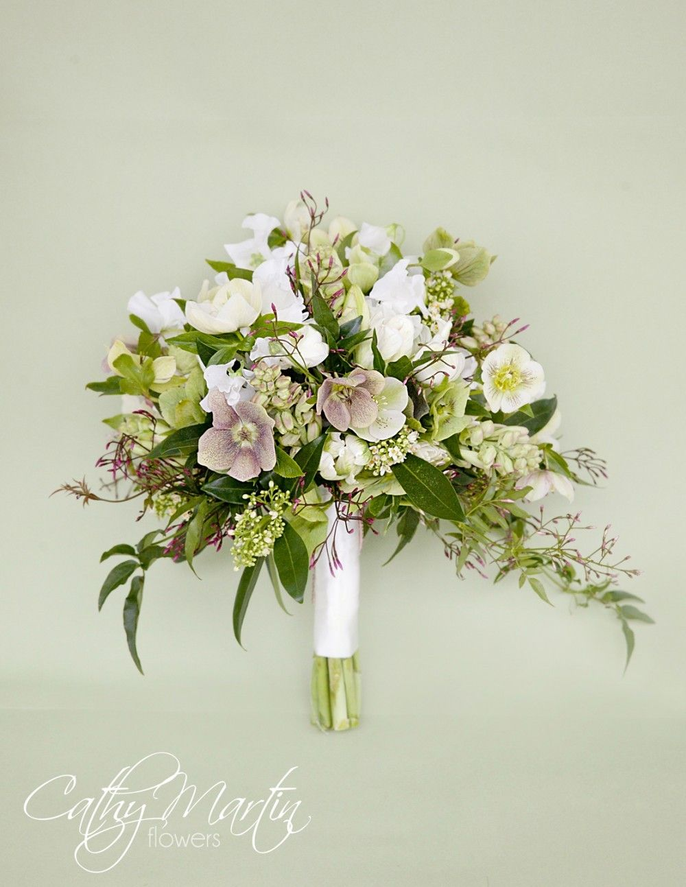 Not only beautiful but must smell wonderful hellebores skimmia hellebores skimmia tulips sweetpea and jasmine in this cathy martin flowers bouquet early spring izmirmasajfo Image collections