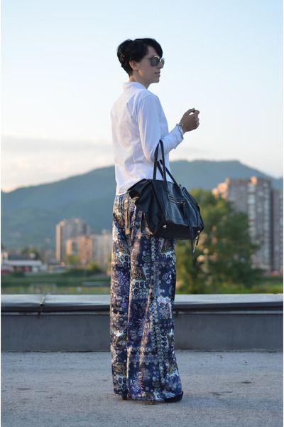 Sunglasses, pumps, and sleek bag take these pajama pants to the next level.