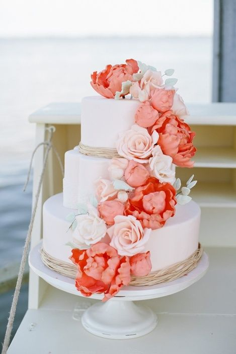 Romantic 3 Tier Wedding Cake With Peach Coral Blooms Except With