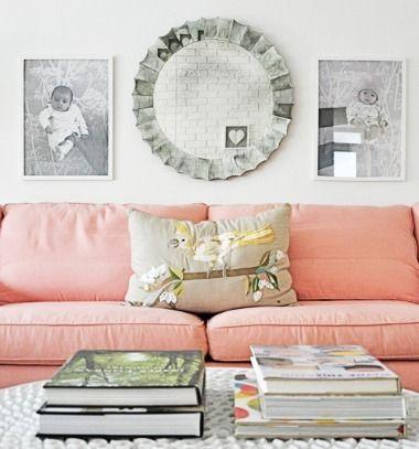 pink walls blue sofa