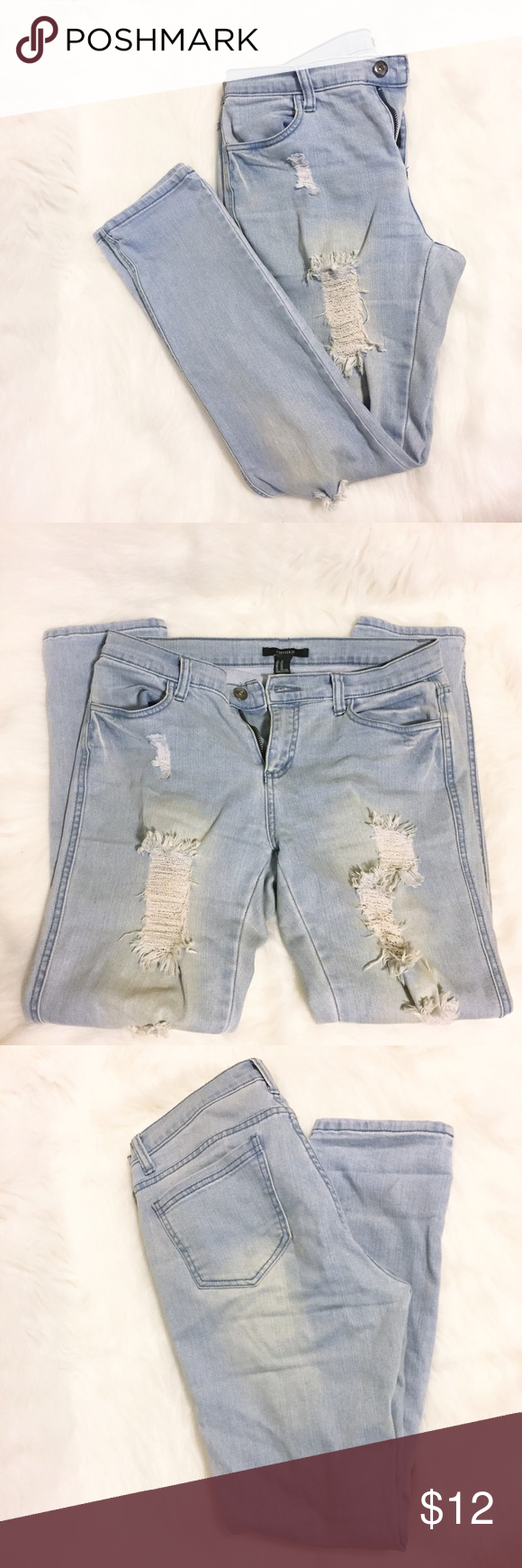 Forever 21 Straight Leg Distressed Denim Forever 21 distressed straight leg jeans in a size 29. Worn a few times. Forever 21 Jeans Straight Leg