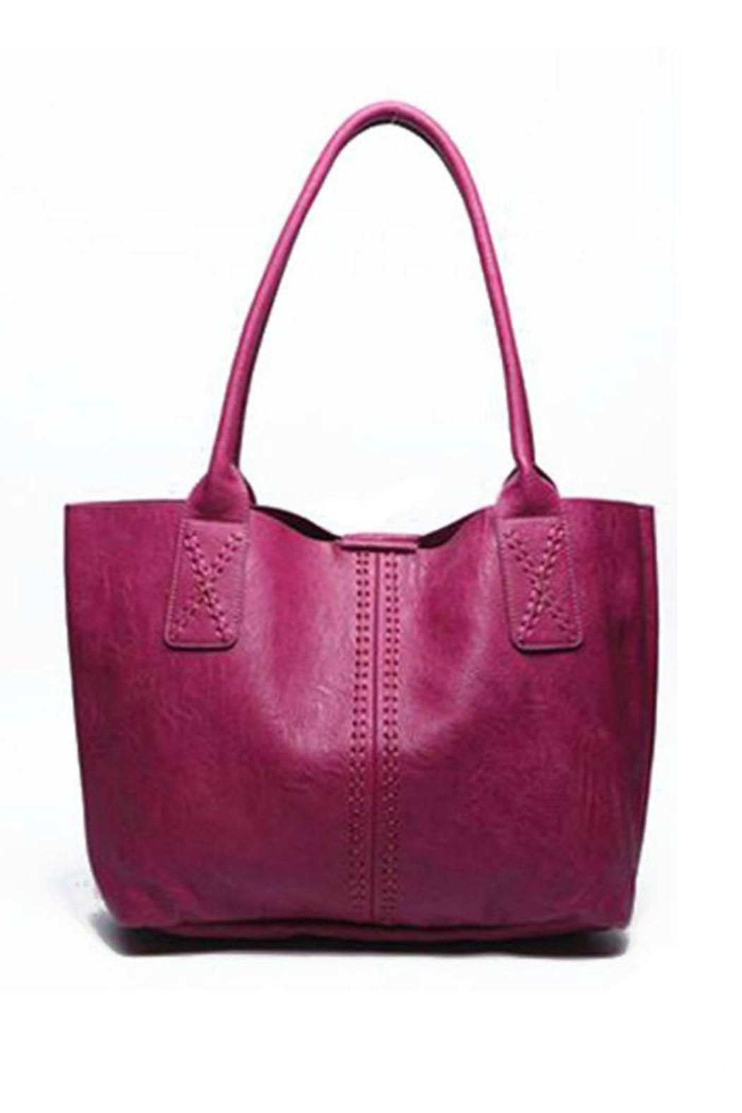 "Heres a killer bag that you can use for anything. We love them cause they are bright and chic, and the detachable square handbag inside.. we just adore. This shopper style tote measures 20"" W, 13"" tall, the inside is 14"" deep and 12"" Tall . It is made of Vegan Leather with a magnetic snap closure. Gold Tone hardware with a inside detachable inside square pouch.    Vegan Leather Tote by Styles Boutique. Bags - Totes Boca Raton, Florida"