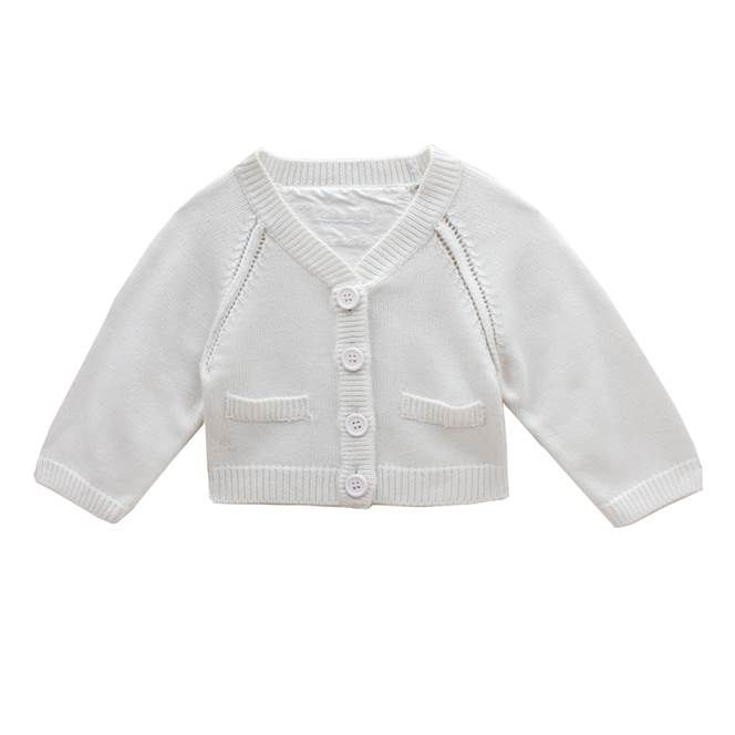 A timeless cut white classic boys white cardigan, finished with ribbed V neckline, cuffs and waistband. Moss stitching on the raglan cut shoulders. Front pockets and chunky buttons.