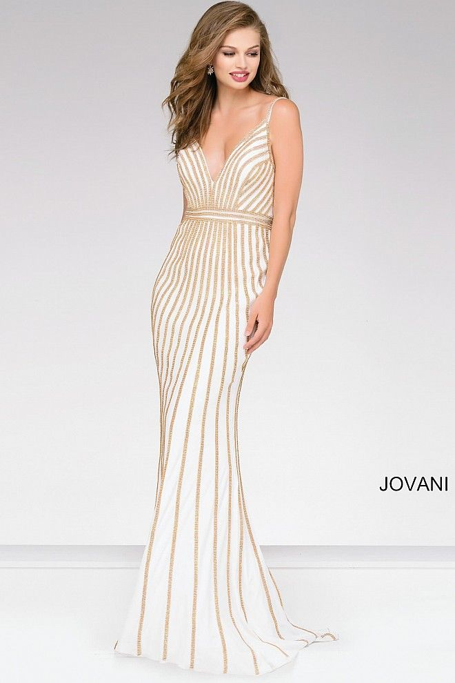 ce11b448a4c94 White and gold beaded mermaid dress with V-neck and back.