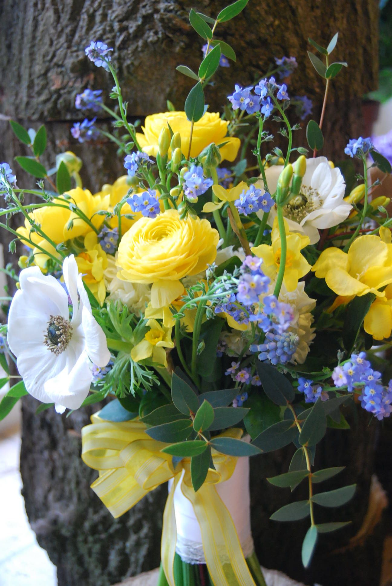 March British Spring Flower Bridal Bouquet Using Forget Me Nots Ranunculus Anemones Freesia A Spring Wedding Bouquets Spring Wedding Flowers Yellow Bouquets