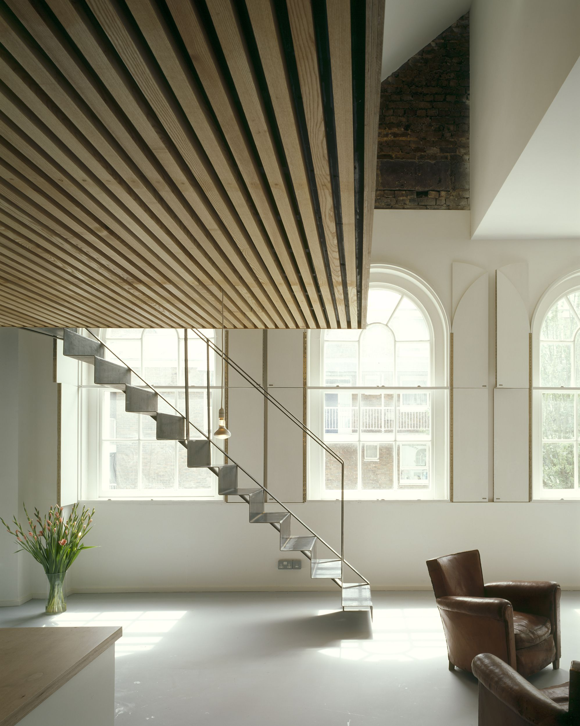 The Orthogonal Untreated Steel Staircase And Timber Mezzanine Provide A