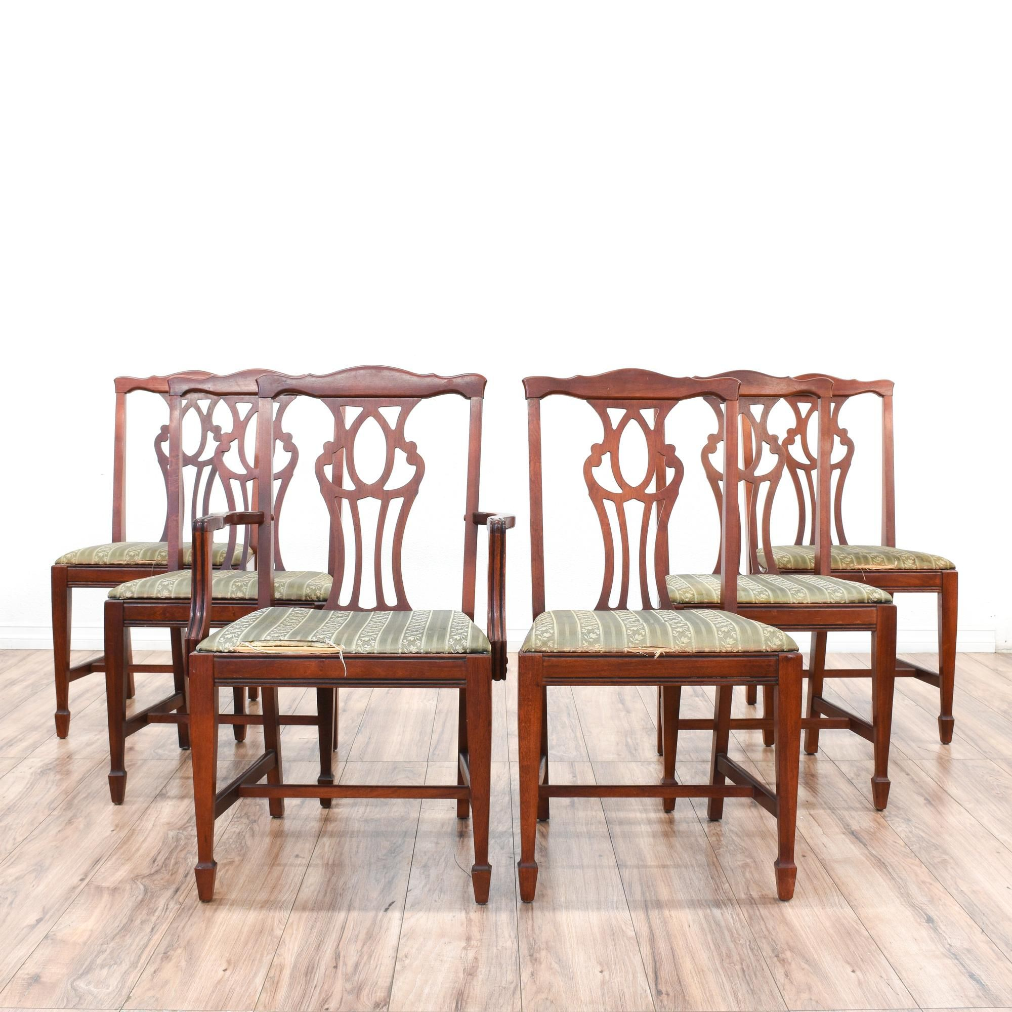 This set of 6 dining chairs is featured in a solid wood with a