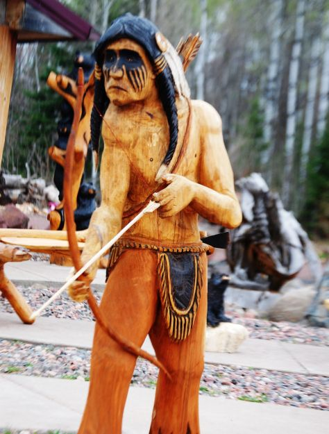 A carving of an indian at grizz works in maple wi unique yard