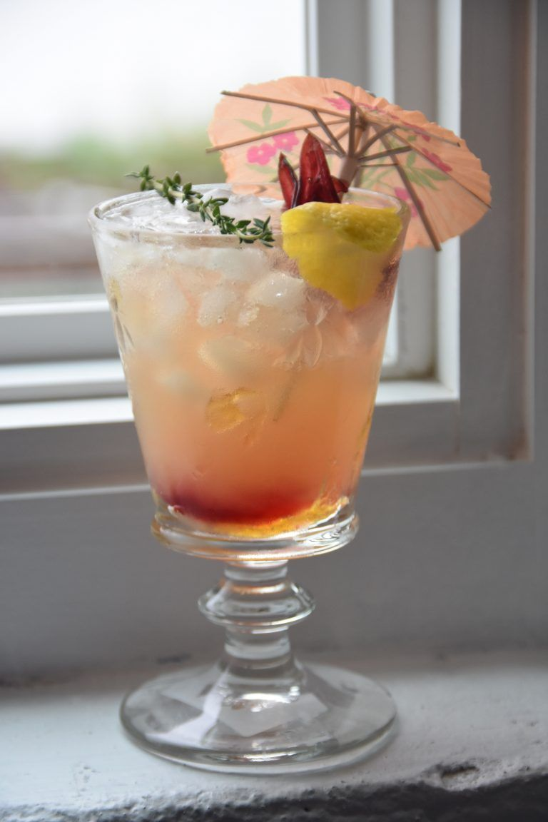 Signature sips modern mai tai classic cocktails beverage and food give this mai tai with hibiscus flowers a try for a new spin on a classic izmirmasajfo