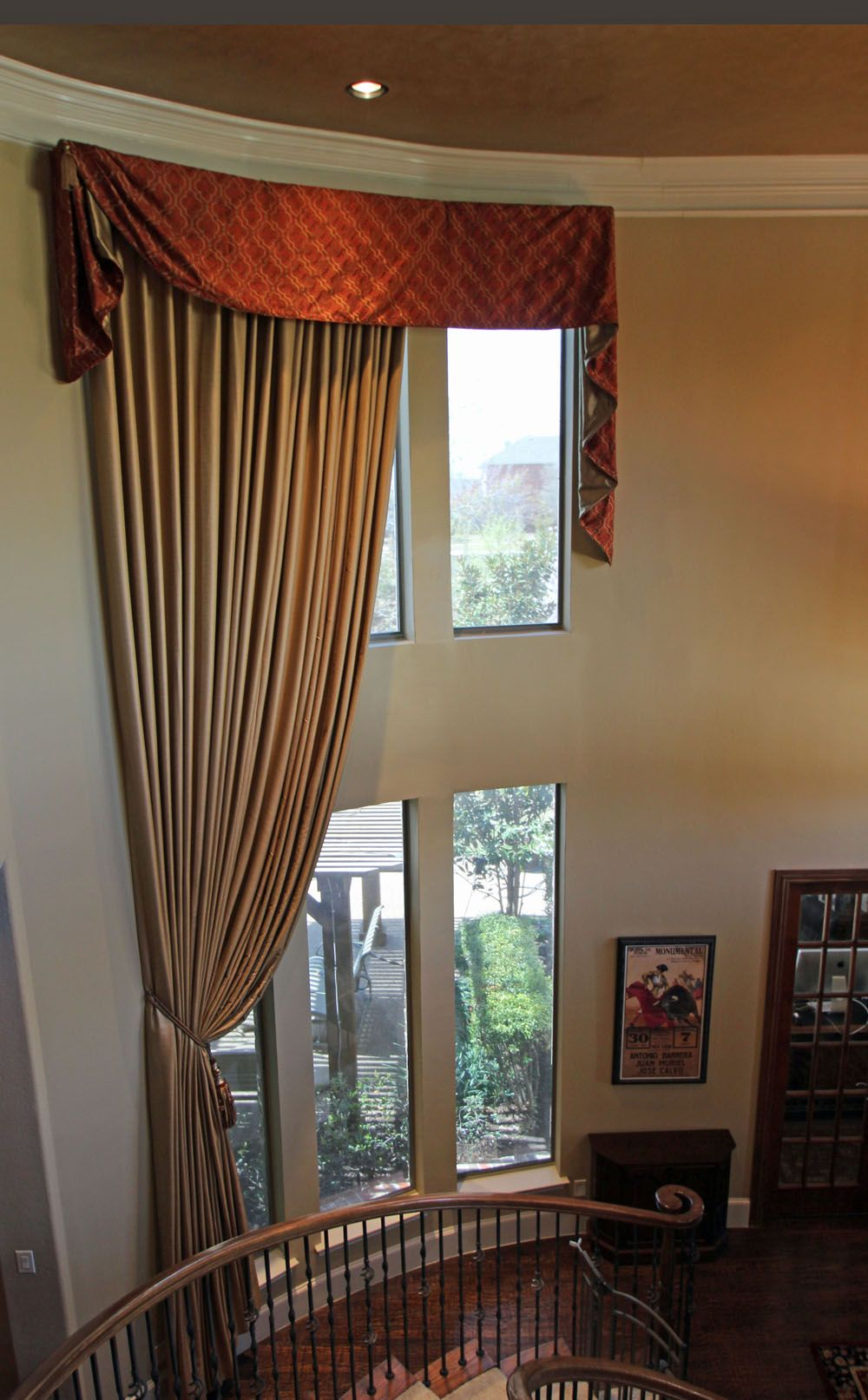 Dramatic 2 story window treatments dresses this slightly ...