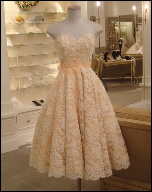 Exquisite lace and peach wedding dress!  I would definitely add some cap sleeves, but the colors are so gorgeous together!