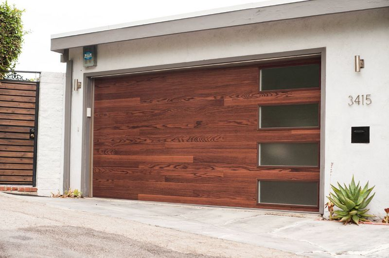 C H I 3216p Woodtones Plank Door In Dark Oak Shown With Plain Glass Windows Contemporary Garage Doors Modern Garage Doors Garage Door Styles