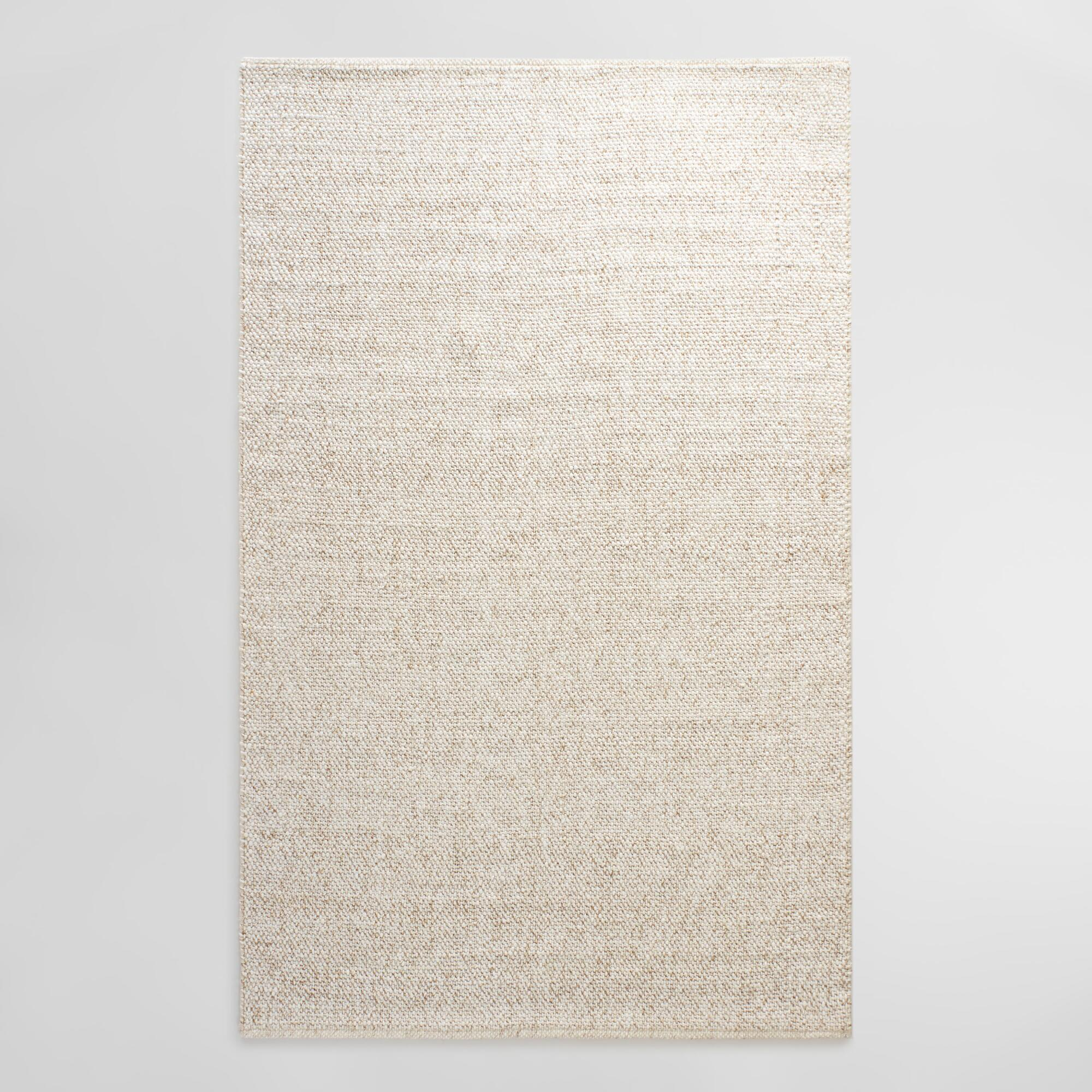 Hand Woven In A Tonal Ivory Hue Speckled With Hints Of
