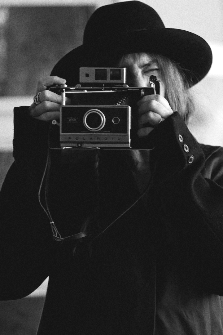 Patti Smith taking a photograph vintage black & white