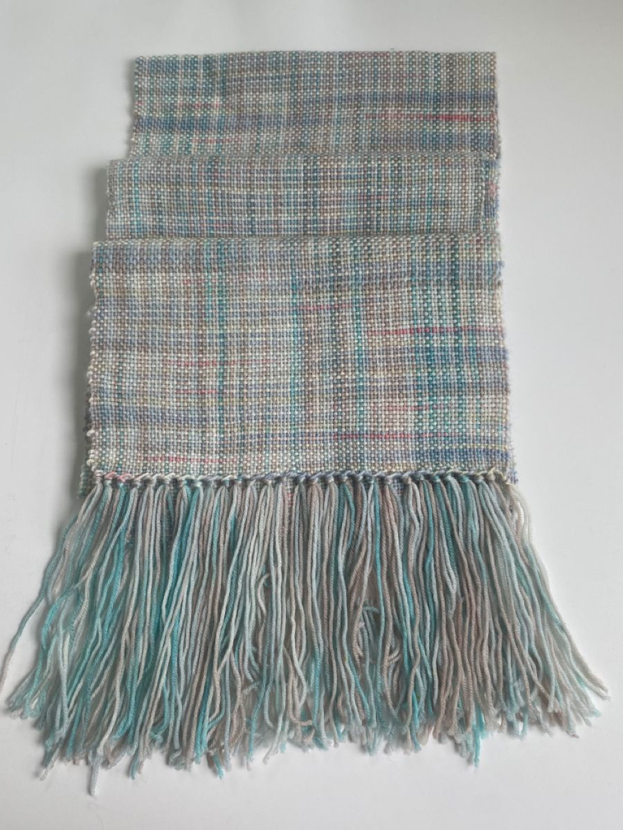 A lovely wool scarf made from two different but similar yarns.