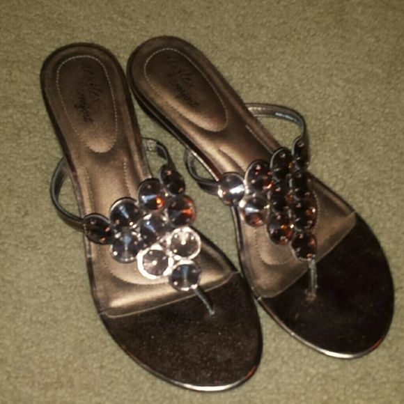 Slip on bronze sandals 10 Slip on bronze sandals.  Tag says 11 but fits like a 10. Lightly worn. Comfort footbed. Shoes Sandals