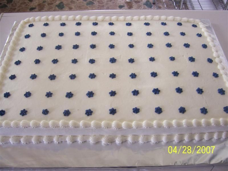 Cake is white cake with buttercream icing and royal icing \
