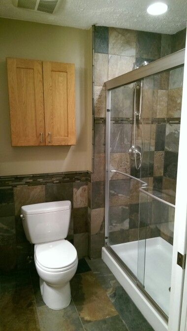 Slaty tile, toto toilet, kohler shower door, kohler hydro rail ...