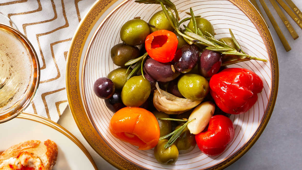Marinated Olives And Peppadews Recipe Marinated Olives Appetizer Recipes Stuffed Peppers