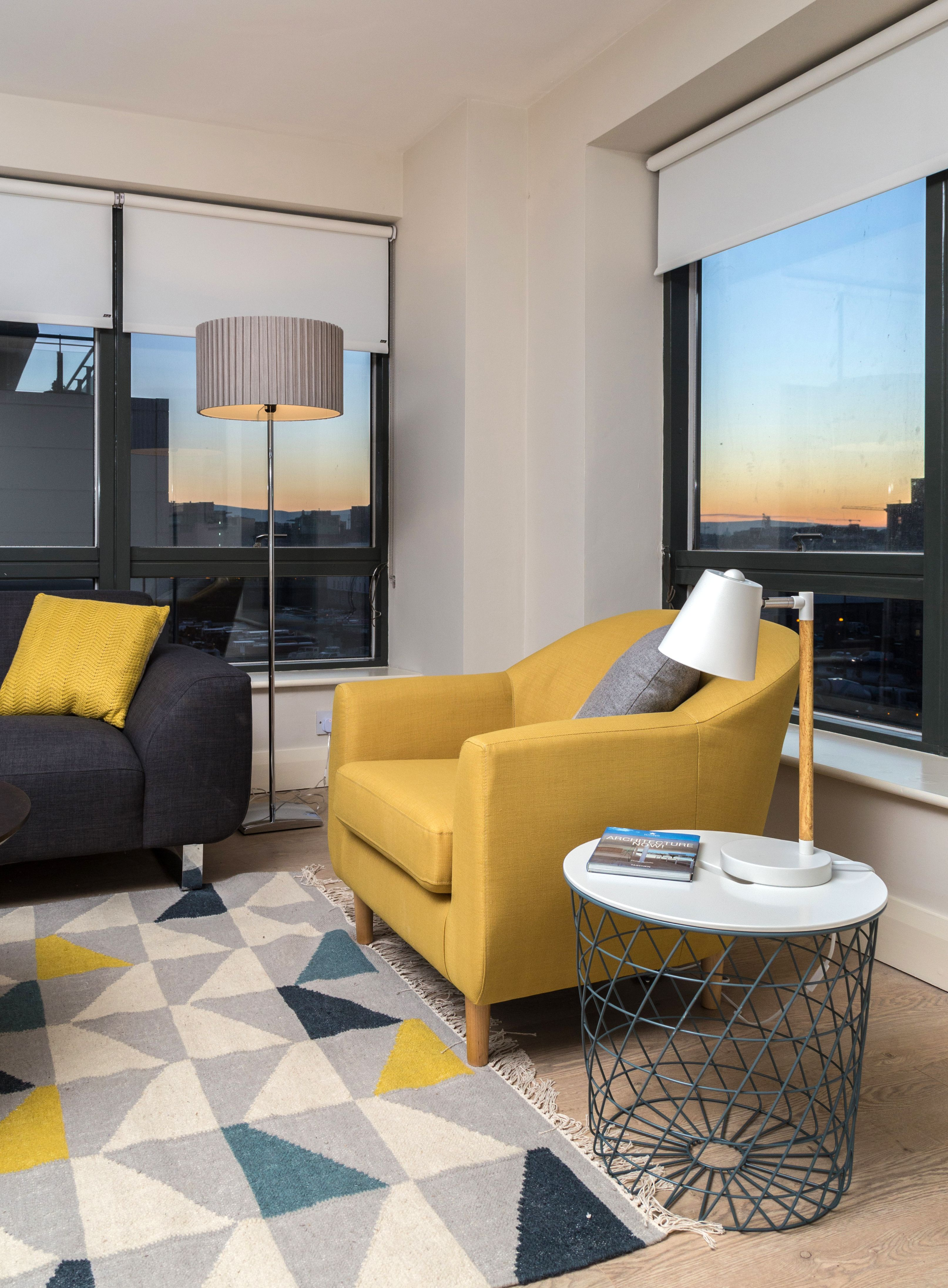Residential Fit Out Apartment Living Area Yellow Blue Teal Dfs Sofa Tubby Armchair Geometric Rug Solan Coffee Table Millennium Tower