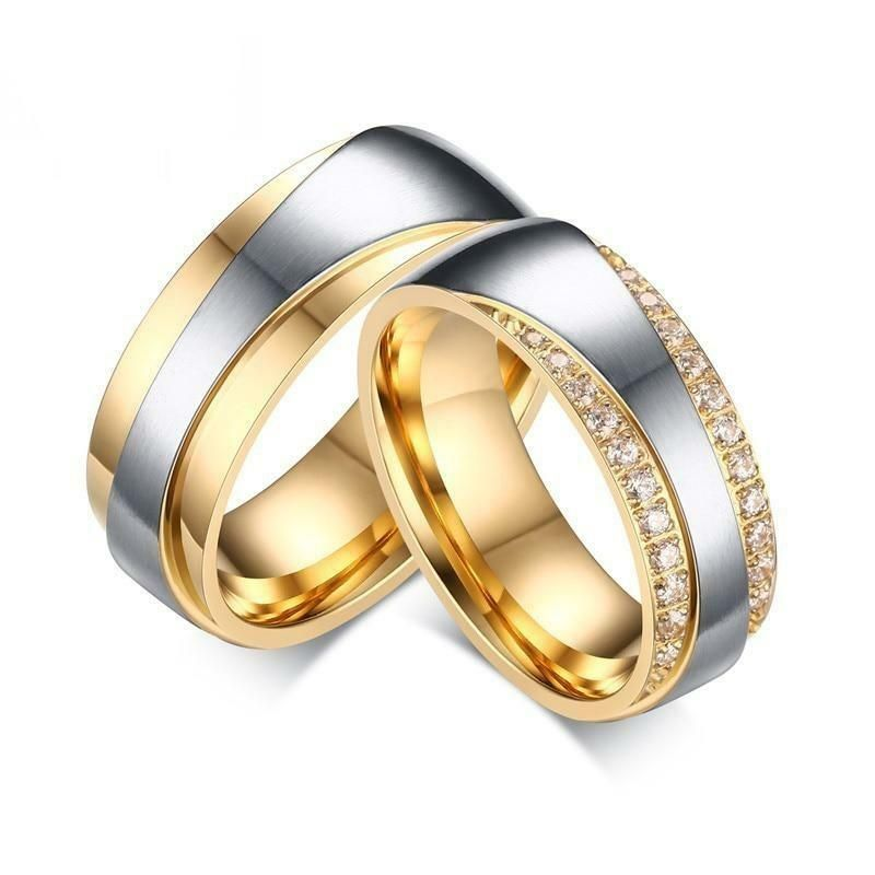 The combination of silver and gold color in this Wedding Ring Set by Innovato Design gives you premium quality of jewelry. Being the symbol of your love for each other, these rings are just right to be of high regard. Made of stainless steel, this amazing wedding ring set has a smooth, glossy finish, and polished surface all over the shank and the ornaments. The ring for the women has a silver lining in between the gold-plated stainless steel linings that are ingrained with cubic zirconia pronge