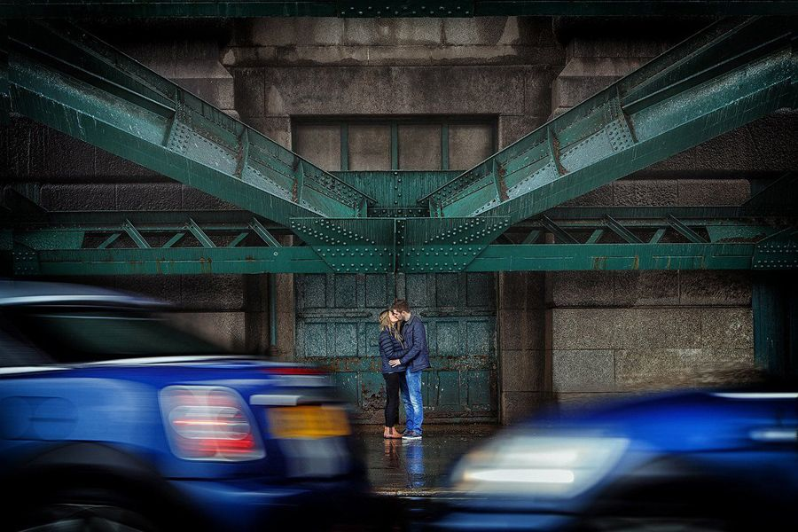 Newcastle-wedding-photography-couple-kissing-as-cars-pass